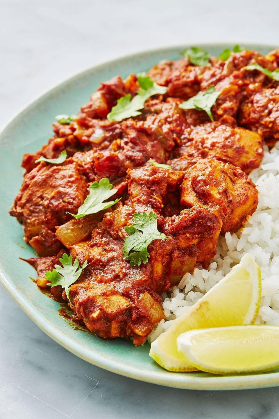 "<p>We love this easy, healthy chicken bhuna recipe, a sure-fire dinner table win - the ultimate crowd pleaser.</p><p>Get the <a href=""https://www.delish.com/uk/cooking/recipes/a28867202/chicken-bhuna/"" rel=""nofollow noopener"" target=""_blank"" data-ylk=""slk:Chicken Bhuna"" class=""link rapid-noclick-resp"">Chicken Bhuna</a> recipe.</p>"