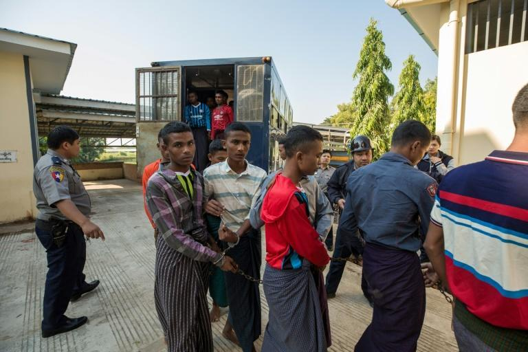 Rohingya arrive at court in Myanmar's Pathein. They are the third group in recent months to be put on trial for attempting to flee Rakhine state