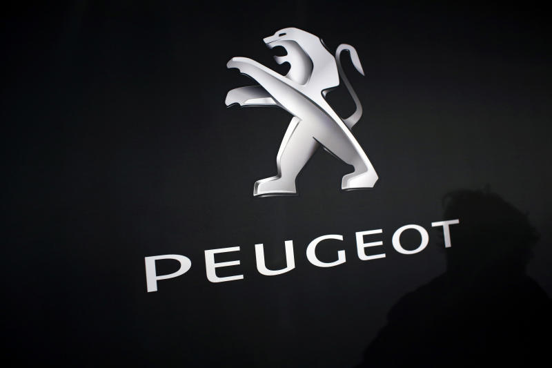 In this March 1, 2018 photo, the logo of Peugeot is displayed at PSA Peugeot Citroen headquarters during the presentation of the company's 2017 full year results, in Rueil-Malmaison, west of Paris, France. Italian-American carmaker Fiat Chrysler Automobiles on Wednesday, Oct. 30, 2019 confirmed that it is in talks with French rival PSA Peugeot, its second bid this year to reshape the global auto industry facing huge challenges with the transition to electric and autonomous vehicles.  (AP Photo/Thibault Camus)