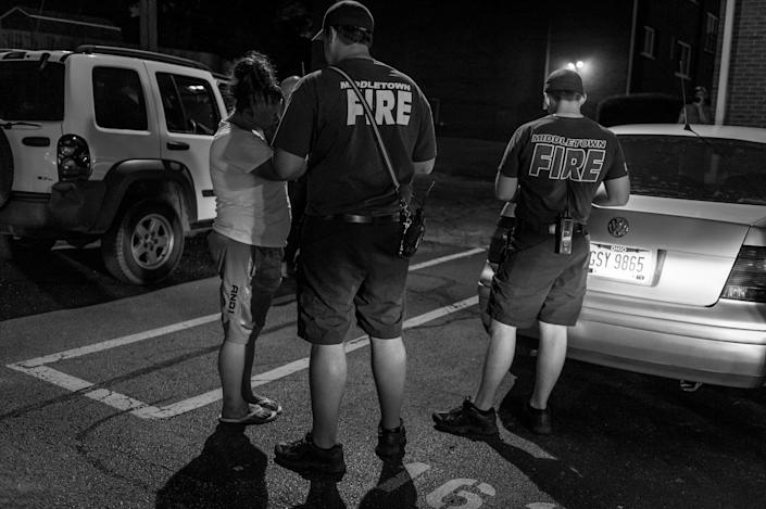 <p>Middletown Fire and Police Department personnel respond to a call about a woman possibly overdosing on heroin.<br> (Photograph by Mary F. Calvert for Yahoo News) </p>