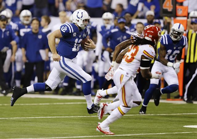 Indianapolis Colts' Andrew Luck (12) runs during the first half of an NFL wild-card playoff football game against the Kansas City Chiefs Saturday, Jan. 4, 2014, in Indianapolis. (AP Photo/Michael Conroy)