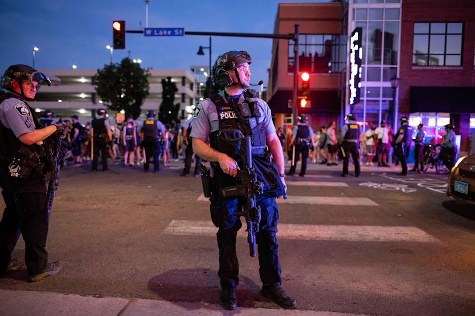 On Tuesday evening, 15 June, 2020, heavily armed Minneapolis police cleared out a memorial site for Winston Smith, a Black man killed by local sheriff's earlier this month under murky circumstances. (AP)