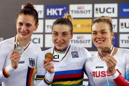 Cycling - UCI Track World Championships - Women's 500m Time Trial Final - Hong Kong, China - 15/4/17 - Germany's Miriam Welte, Russia's Daria Shmeleva and Russia's Anastasiia Voynova celebrate with their medals. REUTERS/Bobby Yip