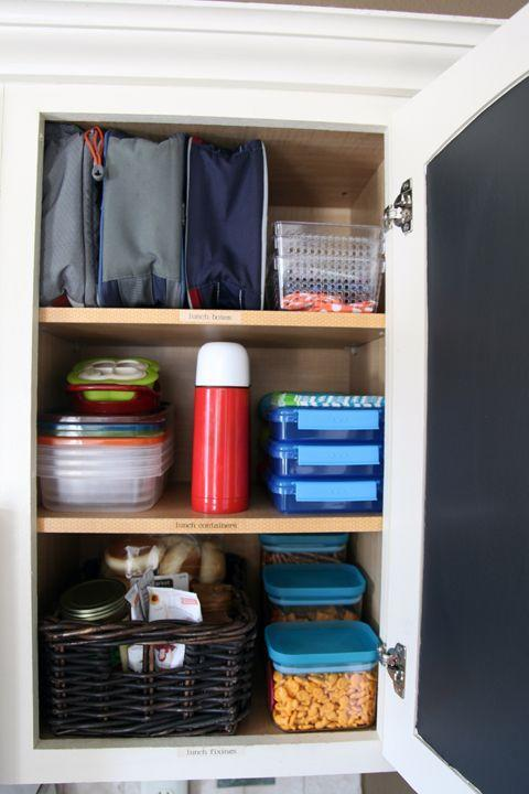 """<p>Conquer those reusable plastic containers once and for all. Store them alongside <a href=""""https://www.goodhousekeeping.com/childrens-products/lunch-box-reviews/g2310/best-kids-lunch-box/"""" rel=""""nofollow noopener"""" target=""""_blank"""" data-ylk=""""slk:lunch boxes"""" class=""""link rapid-noclick-resp"""">lunch boxes</a>, thermoses, and other <a href=""""https://www.goodhousekeeping.com/food-recipes/g27113993/easy-after-school-snacks/"""" rel=""""nofollow noopener"""" target=""""_blank"""" data-ylk=""""slk:pantry snacks"""" class=""""link rapid-noclick-resp"""">pantry snacks </a>for easy access and label where everything goes to keep them straight. </p><p><em><a class=""""link rapid-noclick-resp"""" href=""""http://www.iheartorganizing.com/2013/08/back-to-school-organization.html"""" rel=""""nofollow noopener"""" target=""""_blank"""" data-ylk=""""slk:See more on I Heart Organizing »"""">See more on I Heart Organizing »</a></em></p>"""