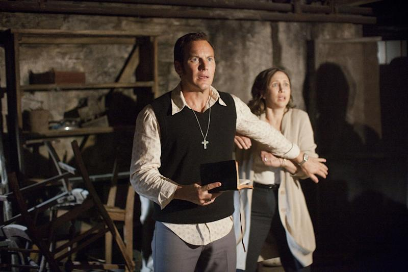 """In this publicity image released by Warner Bros. Pictures, Patrick Wilson portrays Ed Warren, left, and Vera Farmiga portrays Lorraine Warren in a scene from """"The Conjuring."""" (AP Photo/New Line Cinema/Warner Bros. Pictures, Michael Tackett)"""