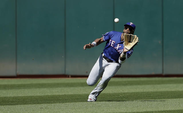 Texas Rangers center fielder Delino DeShields catches a fly ball hit by Oakland Athletics' Marcus Semien during the eighth inning of a baseball game in Oakland, Calif., Wednesday, April 24, 2019. (AP Photo/Jeff Chiu)