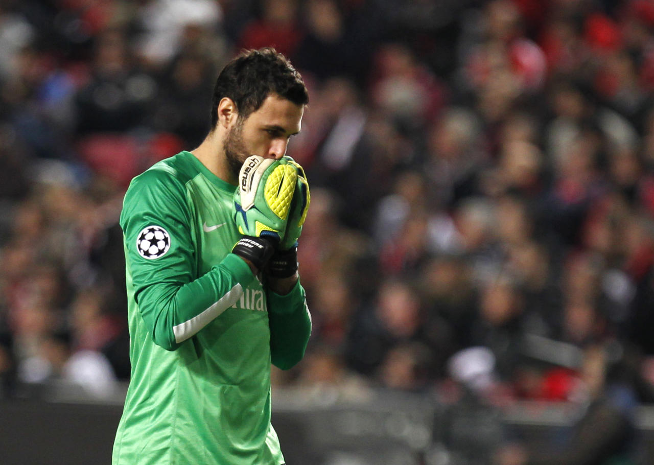 PSG goalkeeper Salvatore Sirigu reacts during a Group C Champions League soccer match between Benfica and PSG at the Luz stadium in Lisbon, Tuesday Dec. 10, 2013. (AP Photo/Francisco Seco)