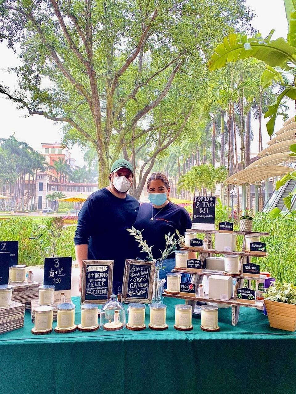 Joel and Tere Ceballos, owners of Éclat Soy Candles, created a new way for customers to smell their candle scents at the Sunday Farmers Market at Shops of Merrick Park amid the pandemic.