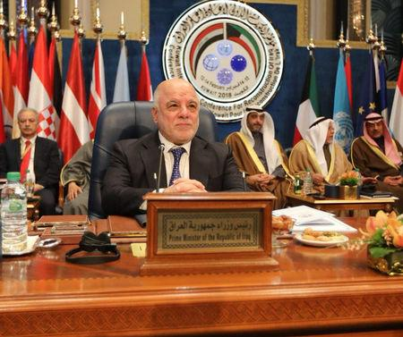 Iraqi Prime Minister Haider al-Abadi attends the Kuwait International Conference for Reconstruction of Iraq, in Bayan, Kuwait, February 14, 2018. Iraqi Prime Minister Media Office/via REUTERS
