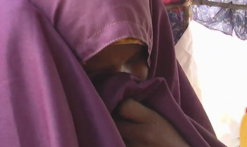 Somali woman Kaltum Mohamed weeps in her shelter in this image taken from TV  in Mogadishu Thursday Aug. 4, 2011. Kaltum Mohamed has lost 4 of her children to famine. Just three weeks ago, she was the mother of five young children. But famine has come to Somalia and claimed the lives of four of them. Only a daughter remains now. (AP Photo/APTN)