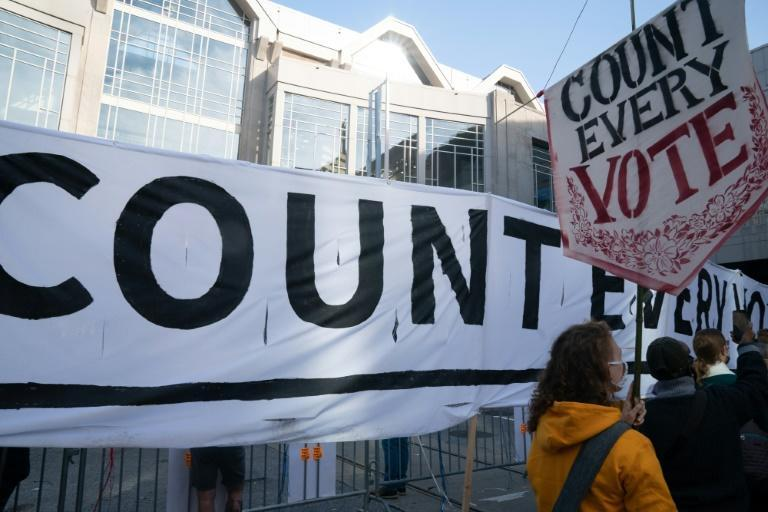 Protesters outside the Pennsylvania Convention Center where ballots in the tight US presidential election were still being counted on Friday
