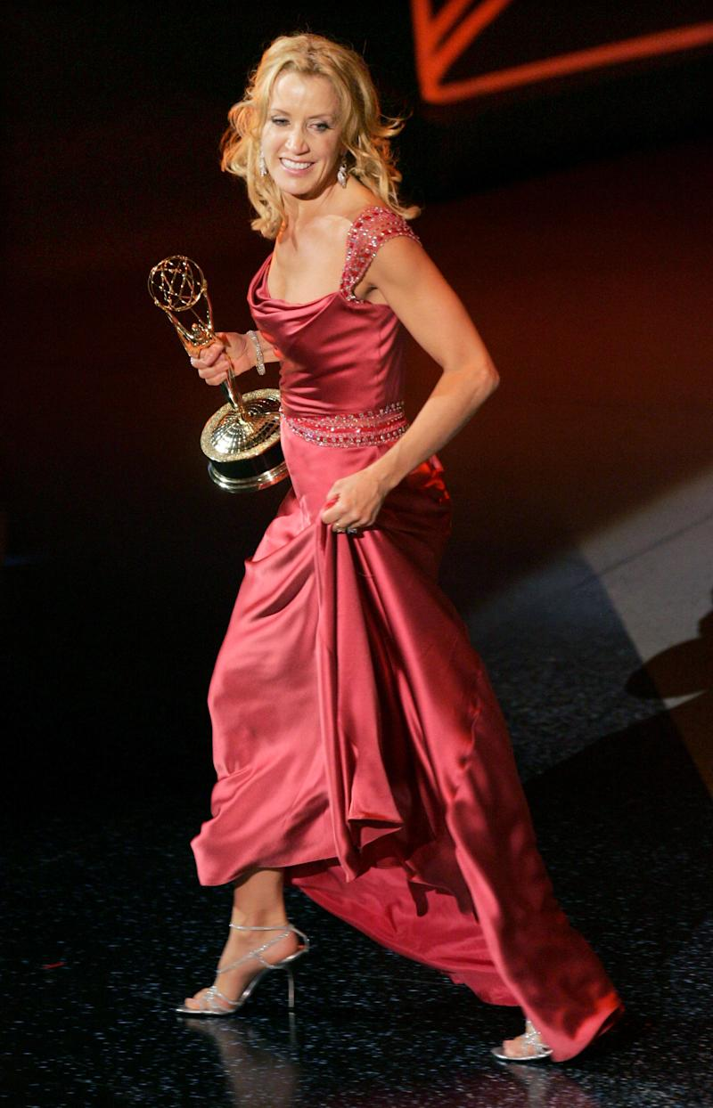"Actress Felicity Huffman accepts the award for Outstanding Lead Actress in a Comedy Series at the 57th annual Primetime Emmy Awards at the Shrine Auditorium in Los Angeles September 18, 2005. Huffman won for her role in the series ""Desperate Housewives."" REUTERS/Robert Galbraith GMH/DH"