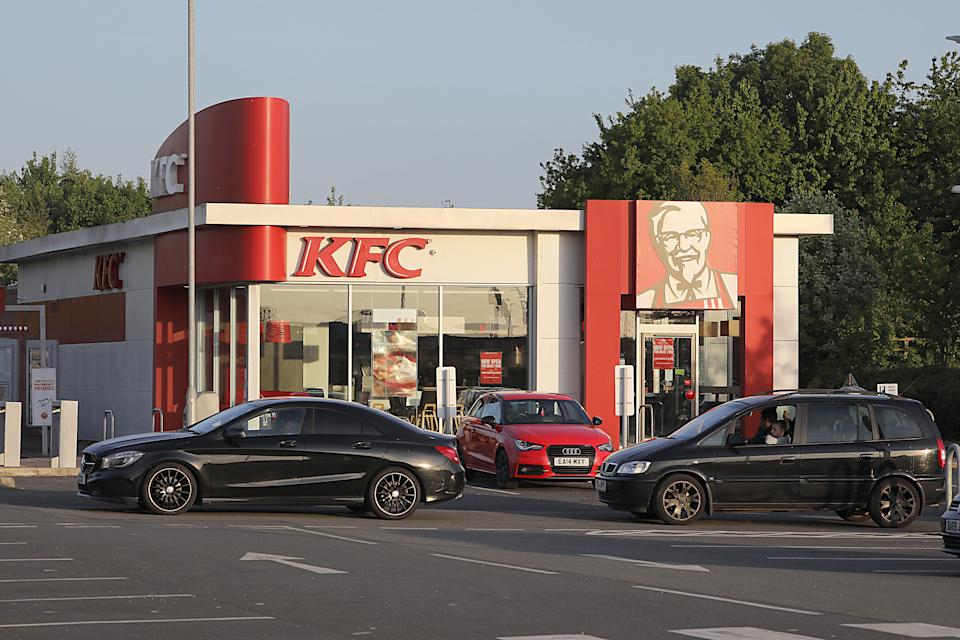 Huge queues lasting up to two hours formed after a KFC drive-thru reopened unexpectedly in Rhuddlan, north Wales (Picture: Wales News)
