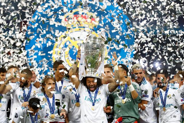 Soccer Football - Champions League Final - Real Madrid v Liverpool - NSC Olympic Stadium, Kiev, Ukraine - May 26, 2018 Real Madrid's Marcelo lifts the trophy as they celebrate winning the Champions League REUTERS/Kai Pfaffenbach
