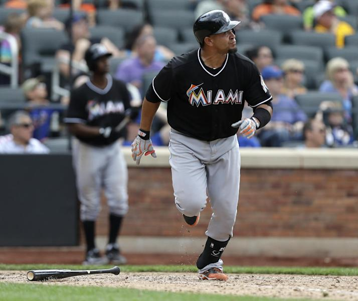 Miami Marlins Miguel Olivo watches his tenth-inning, two-run, home run off New York Mets relief pitcher Robert Carson in the Marlins 8-4 victory over the Mets in a baseball game in New York, Sunday, June 9, 2013. (AP Photo/Kathy Willens)