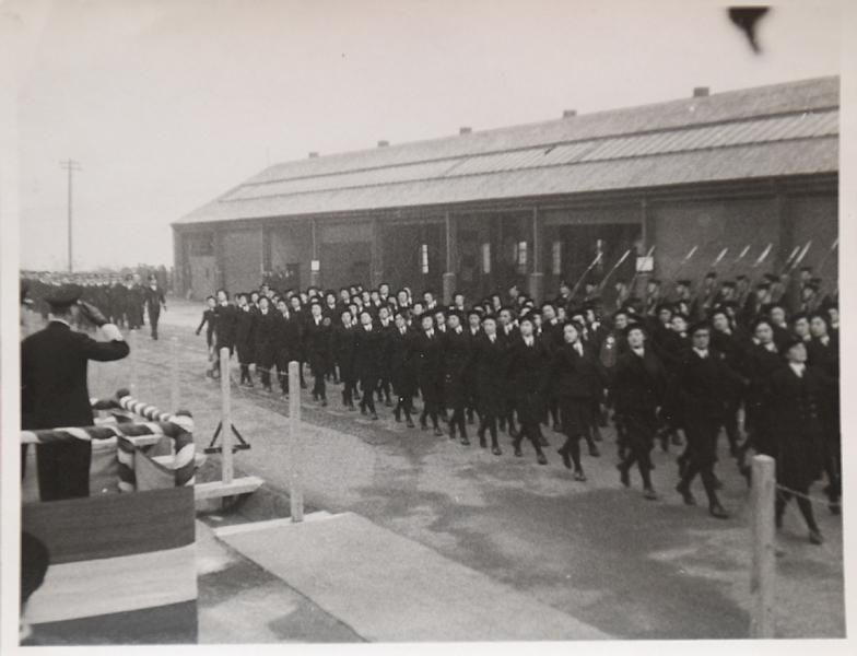 A reproduction of a black and white photograph taken in 1944 and shown to AFP by former D-Day switchboard operator Marie Scott, shows personnel including her parading in front of Britain's King George VI (L) at the HQ of the Allied Expeditionary Force at Fort Southwick in Portsmouth, southern England. (AFP Photo/HO)