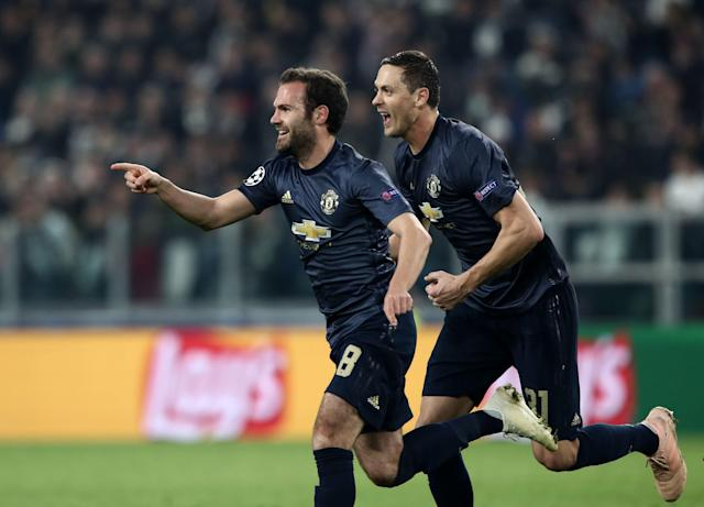 Juan Mata celebrates after scoring for Manchester United