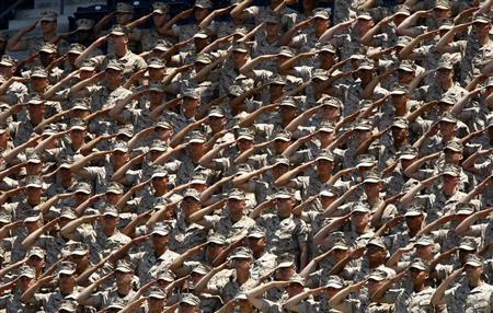United States Marines salute from the stands during the American National Anthem in San Diego