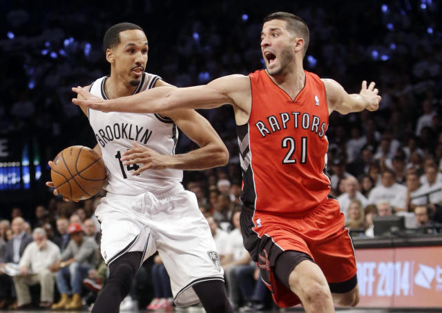 Toronto Raptors' Greivis Vasquez (21) defends Brooklyn Nets' Shaun Livingston (14) during the second half of Game 6 of the opening-round NBA basketball playoff series Friday, May 2, 2014, in New York. The Nets won 97-83. (AP Photo/Frank Franklin II)