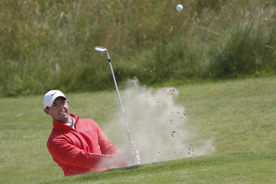Northern Ireland's Rory McIlroy play out of a bunker on the 6th green during a practice round for the British Open Golf Championship at Royal St George's golf course Sandwich, England, Tuesday, July 13, 2021. The Open starts Thursday, July, 15. (AP Photo/Peter Morrison)