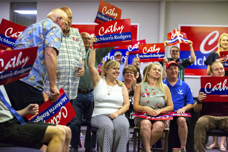 6th District Representative, Position 2, Legislative District 6 candidate Jenny Graham, center, cheers alongside other Cathy McMorris Rodgers supporters after finding out that McMorris Rodgers won the 5th House District in the primary election, Tuesday, Aug. 7, 2018, in Spokane, Wash. (Libby Kamrowski/The Spokesman-Review via AP)a
