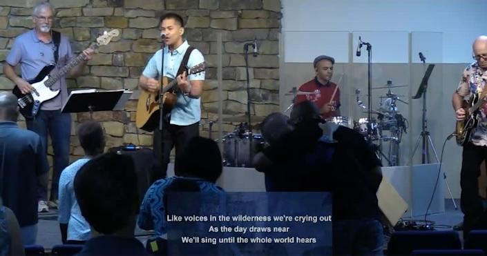 Pastor Ron Arbaugh can be spotted hugging an attendee in this screenshot from a June 21 service at Calvary Chapel of San Antonio. (Photo: Calvary Chapel San Antonio / Vimeo / Screenshot)