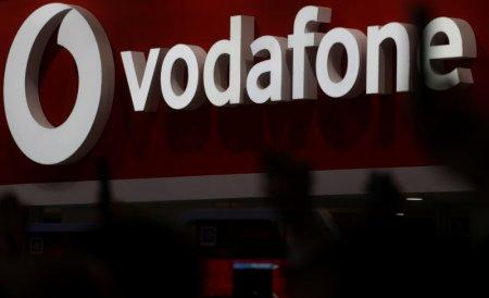 The Vodafone logo is seen at the Mobile World Congress in Barcelona, Spain, February 28, 2018. REUTERS/Sergio Perez