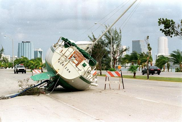 <p>A sailboat rests on the Rickenbacker Causeway to Key Biscayne with the Miami downtown skyline in the background August 26, 1992 two days after Hurricane Andrew ripped through south Florida. (Rick Wilking /Landov/Reuters) </p>