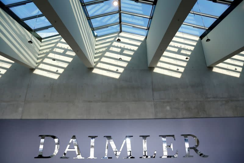 FILE PHOTO: The Daimler logo is seen before the carmaker's annual shareholder meeting in Berlin
