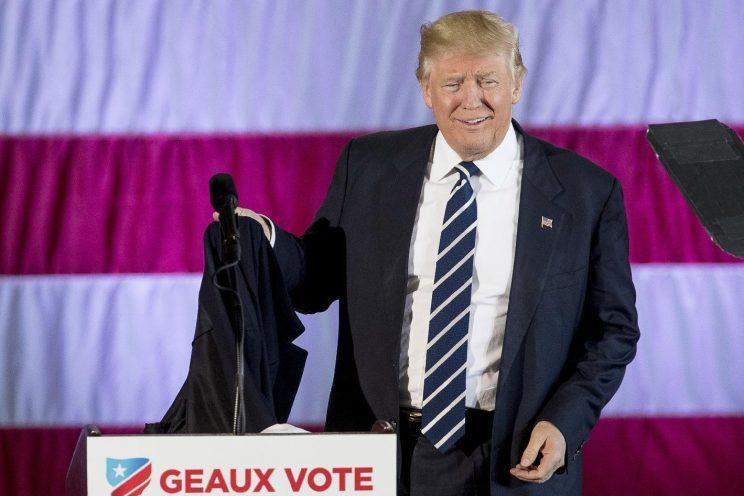 President-elect Donald Trump takes off his coat while speaking at a rally at Dow Chemical in Baton Rouge, La. (Photo: Andrew Harnik/AP)