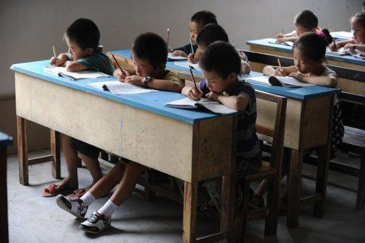 Chinese school children in a classroom in Hefei, east China's Anhui province. China has long been known for its highly disciplined approach to education, but parents and lawmakers alike are beginning to question the wisdom of putting so much pressure on young children