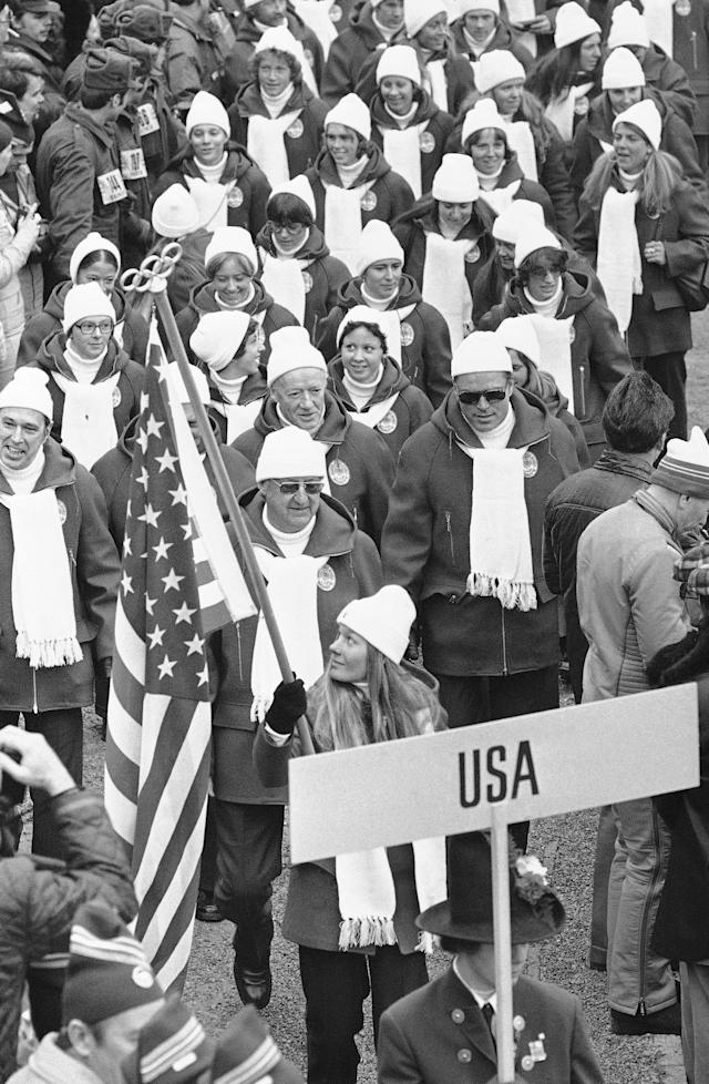 Alpine skier Cindy Nelson, of Lutsen, Mn., is the flag-bearer for the United States team marching inside the Bergisel stadium in the opening ceremony of the 12th Winter Olympic Games on Feb. 4, 1976 in Innsbruck. (AP Photo)