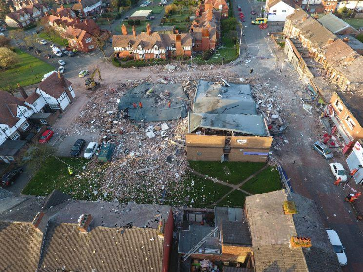 Shocking aerial drone footage has shown the devastation left by a huge explosion that flattened a restaurant, leaving two people seriously injured and dozens more in hospital.