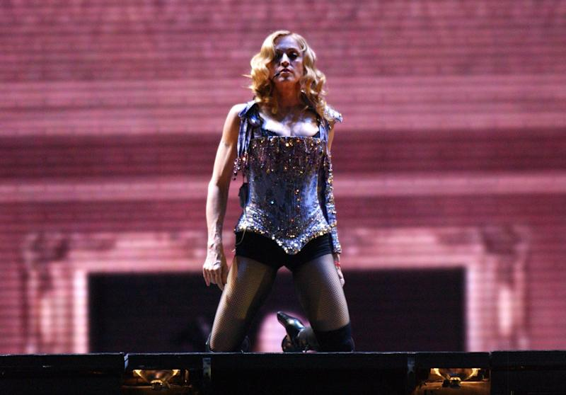 Singer Madonna performs live on stage at Earls Court in central London, as she begins the London leg of her 're-Invention' world tour.
