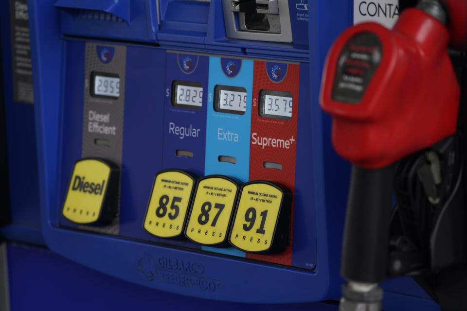 FILE - In this May 9, 2021, file photo prices are illuminated above the levers for the different grades of gasoline available at a pump at an Exxon station in Littleton, Colo. Congressional Democrats are calling top executives at ExxonMobil and other oil giants to testify at a House hearing as lawmakers investigate what they say is a long-running, industry-wide campaign to spread disinformation about the role of fossil fuels in causing global warming. (AP Photo/David Zalubowski, File)