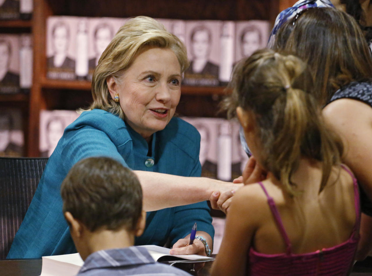 "Former Secretary of State Hillary Rodham Clinton greets fans at a book signing for her new book ""Hard Choices,"" her recounting of her time as President Barack Obama's top diplomat, at the Tattered Cover Book store in Denver on Monday, June 23, 2014. (AP Photo/Ed Andrieski)"