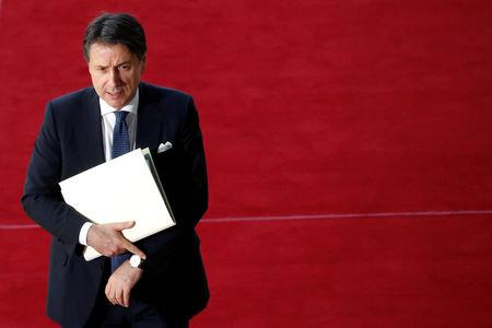 FILE PHOTO: Italian Prime Minister Giuseppe Conte arrives at an extraordinary European Union leaders summit to discuss Brexit, in Brussels, Belgium April 10, 2019.  REUTERS/Susana Vera