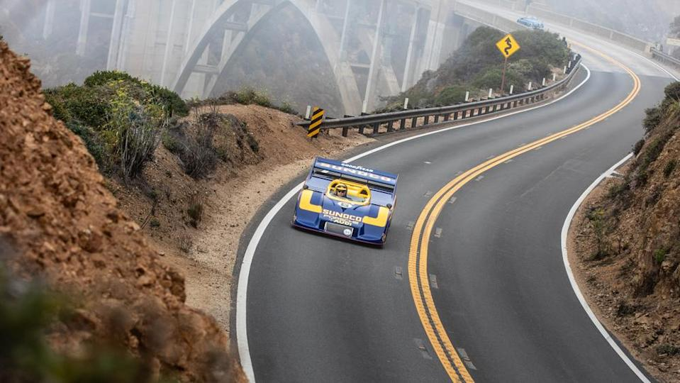 A 1973 Porsche 917/30 Can-Am Spyder winds along the coast during the Pebble Beach Tour d'Elegance. - Credit: Photo by Tom O'Neal, courtesy of Rolex.