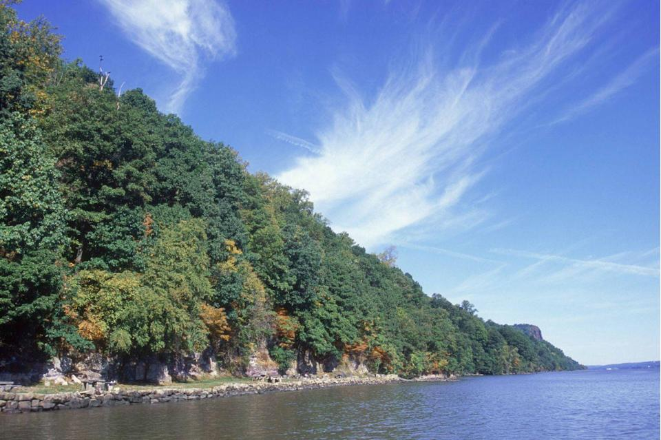 """<p><strong>The Drive: </strong><span class=""""redactor-unlink"""">Palisades Scenic Byway</span></p><p><strong>The Scene: </strong>Travel beside the Hudson River through a section of New Jersey's national historic landmark, <a href=""""https://www.tripadvisor.com/ShowUserReviews-g46420-r131464806-Englewood_Cliffs_New_Jersey.html"""" rel=""""nofollow noopener"""" target=""""_blank"""" data-ylk=""""slk:Palisades Interstate Park"""" class=""""link rapid-noclick-resp"""">Palisades Interstate Park</a>. The 500-foot-high Palisades look especially amazing during the autumn months. You'll also get a glimpse of the <a href=""""https://www.tripadvisor.com/Attractions-g60763-Activities-oa30-New_York_City_New_York.html"""" rel=""""nofollow noopener"""" target=""""_blank"""" data-ylk=""""slk:New York City"""" class=""""link rapid-noclick-resp"""">New York City</a> skyline across the river. </p><p><strong>The Pit-Stop: </strong>Your little ones will love to learn all about the nature at the <a href=""""https://www.tripadvisor.com/Attraction_Review-g46863-d1832921-Reviews-Tenafly_Nature_Center-Tenafly_New_Jersey.html"""" rel=""""nofollow noopener"""" target=""""_blank"""" data-ylk=""""slk:Tenafly Nature Center"""" class=""""link rapid-noclick-resp"""">Tenafly Nature Center</a>. </p>"""