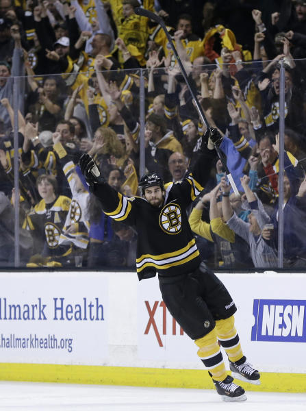 Boston Bruins defenseman Adam McQuaid celebrates his goal against the Pittsburgh Penguins during the third period of Game 4 in the Eastern Conference finals of the NHL hockey Stanley Cup playoffs, in Boston on Friday, June 7, 2013. (AP Photo/Elise Amendola)