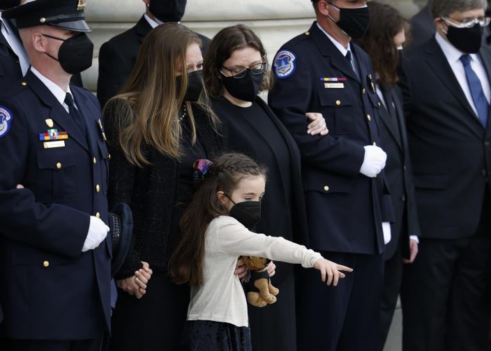 "The family, including daughter Abigail, watch as the flag-draped casket of U.S. Capitol Police officer William ""Billy"" Evans, arrives to lie in honor at the U.S. Capitol, Tuesday, April 13, 2021 in Washington. (Carlos Barria/Pool via AP)"