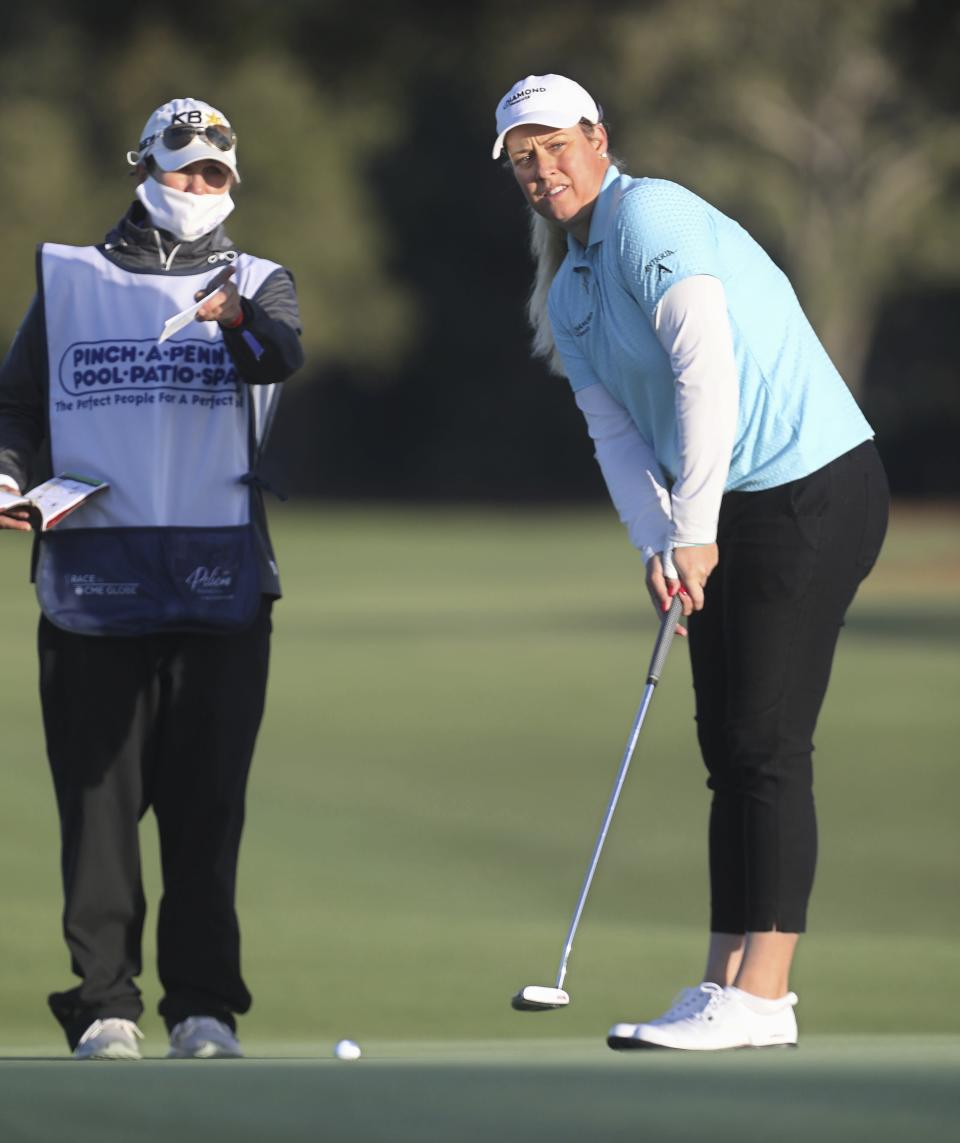 Brittany Lincicome, right, looks at a putt with her caddie Missy Pederson, left, on the 11th hole during the first round of the LPGA Pelican Women's Championship golf tournament at Pelican Golf Club, Thursday, Nov. 19 2020, Belleair, Fla. (Scott Keeler/Tampa Bay Times via AP)