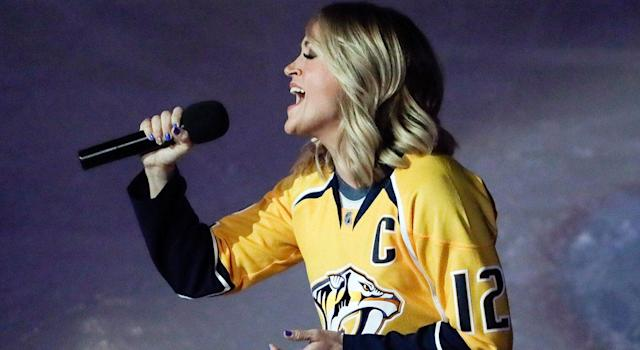 <p>Country singer Carrie Underwood, the wife of Nashville centre Mike Fisher, sings the national anthem during Round 1 against the Blackhawks,<br> (Mark Humphrey/AP) </p>