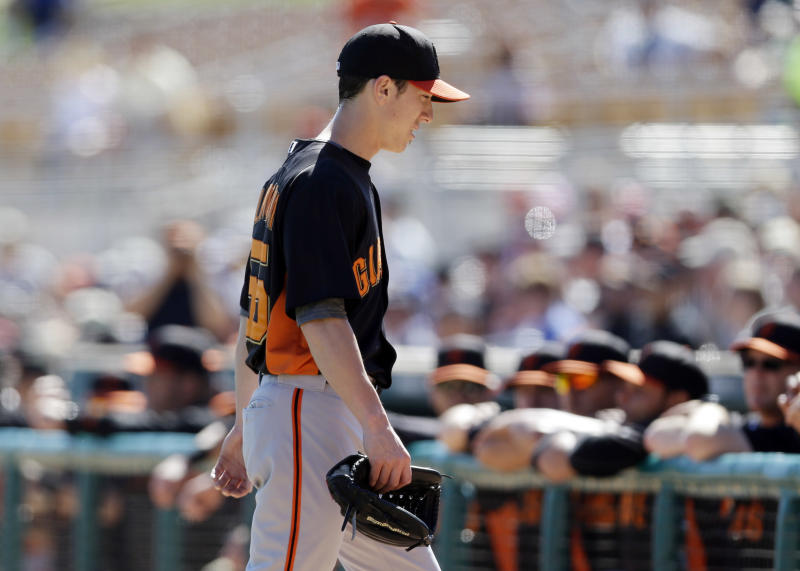San Francisco Giants starting pitcher Tim Lincecum walks to the dugout after being pulled from the game against the Los Angeles Dodgers during the second inning of an exhibition spring training baseball game on Tuesday, Feb. 26, 2013 in Glendale. Ariz. (AP Photo/Marcio Jose Sanchez)