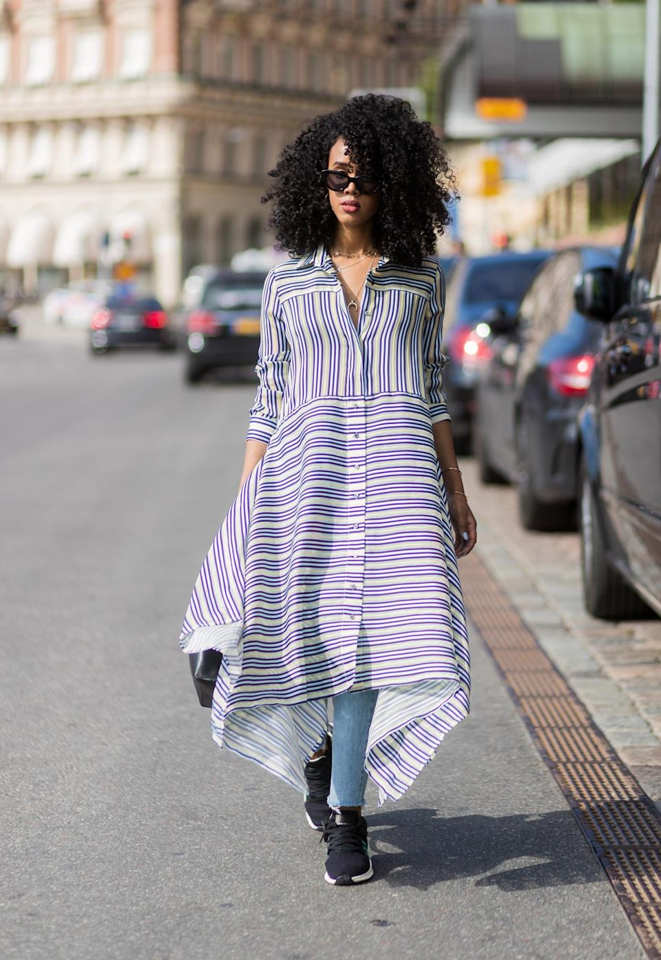 <p>Nothing tempers a tailored dress more than layering skinny jeans underneath with workout-inspired sneakers to finish.</p>
