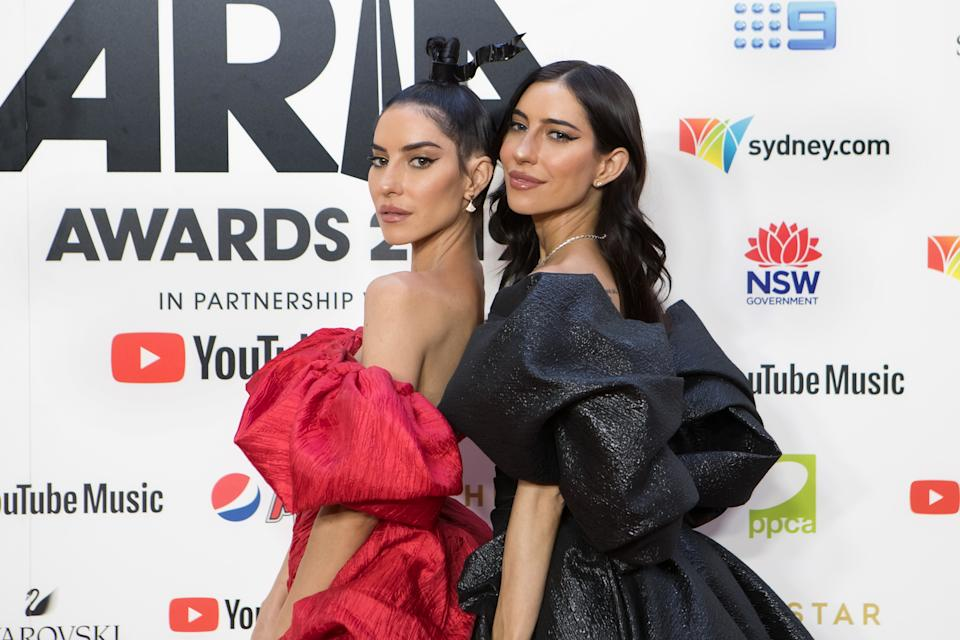 Lisa Origliasso and Jessica Origliasso of The Veronicas pose on the red carpet at the 33rd Annual ARIA Awards 2019 at The Star on November 27, 2019 in Sydney, Australia