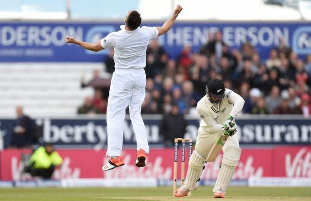 England's James Anderson leaps with joy after dismissing New Zealand's Martin Guptill on a rain-affected day at Headingley