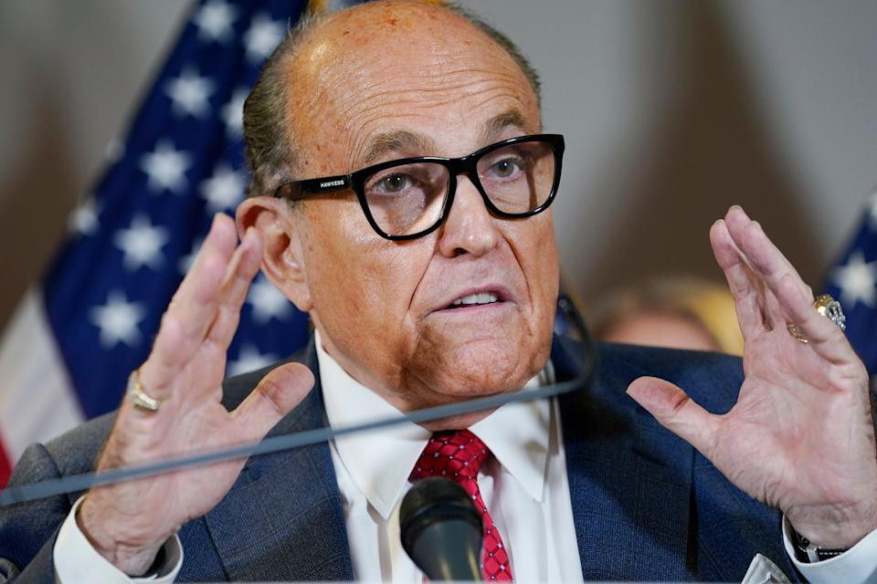 Rudy Giuliani is facing an investigation by the FBI into whether he broke foreign lobbying laws in his dealings with Ukraine (AP)
