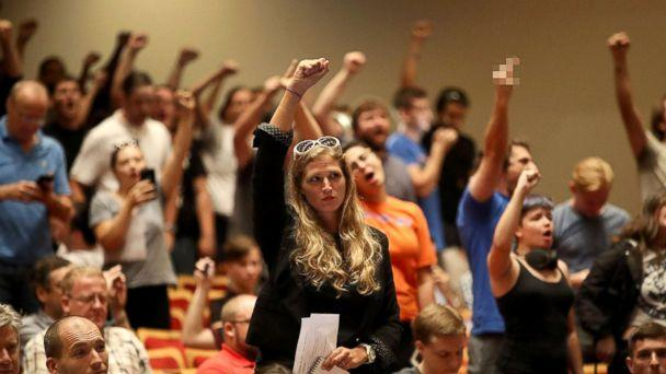 PHOTO: People react as white nationalist Richard Spencer, who popularized the term 'alt-right' speaks at the Curtis M. Phillips Center for the Performing Arts, Oct. 19, 2017, in Gainesville, Florida. (Joe Raedle/Getty Images)