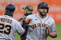 San Francisco Giants' Darin Ruf, right, rounds third to greetings from third base coach Ron Wotus (23) after hitting a solo home run off Pittsburgh Pirates starting pitcher Tyler Anderson during the first inning of a baseball game in Pittsburgh, Saturday, May 15, 2021. (AP Photo/Gene J. Puskar)